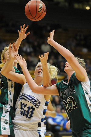 Broomfield's Bre Burgesser fights for the ball under the basket against Conifer's Molly Sears during the Final Four game at the Coors Event Center in Boulder on Wednesday <br /> <br /> March 10, 2010<br /> Staff photo/David R. Jennings