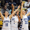 Broomfield's Kody Bradfield, left, Tyana Medema and Millie Reeves give a cheer for a three pointer against Conifer during the Final Four game at the Coors Event Center in Boulder on Wednesday. the Eagles defeated the Lobos 59 to 32. <br /> <br /> March 10, 2010<br /> Staff photo/David R. Jennings