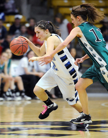 Broomfield's Brittney Zec drives the ball past Conifer's Cara Walderman during the Final Four game at the Coors Event Center in Boulder on Wednesday <br /> <br /> March 10, 2010<br /> Staff photo/David R. Jennings