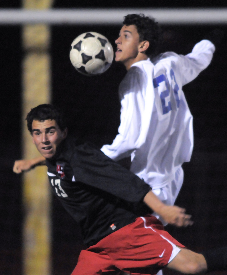 Broomfield's Colton Lamb goes head to head with Dylan Schwantes, Durango, during Wednesday's quarter finals game at Elizabeth Kennedy Stadium.<br /> November 3, 2010<br /> staff photo/David R. Jennings