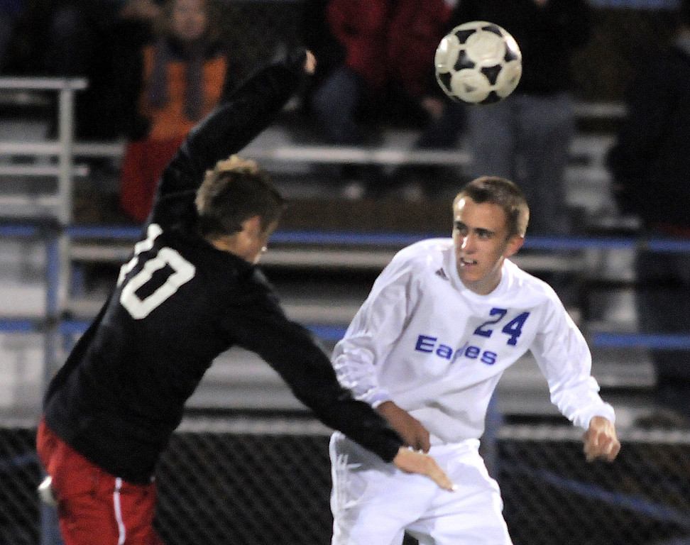 Broomfield's Clay Fiscus fights for the ball with Durango's Joseph Casey during Wednesday's quarter finals game at Elizabeth Kennedy Stadium.<br /> November 3, 2010<br /> staff photo/David R. Jennings
