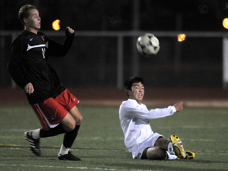 Broomfield's Alex Tagawa kicks the ball from the ground past Matthew Emmanuel-Ogier, Durango, during Wednesday's quarter finals game at Elizabeth Kennedy Stadium.<br /> November 3, 2010<br /> staff photo/David R. Jennings