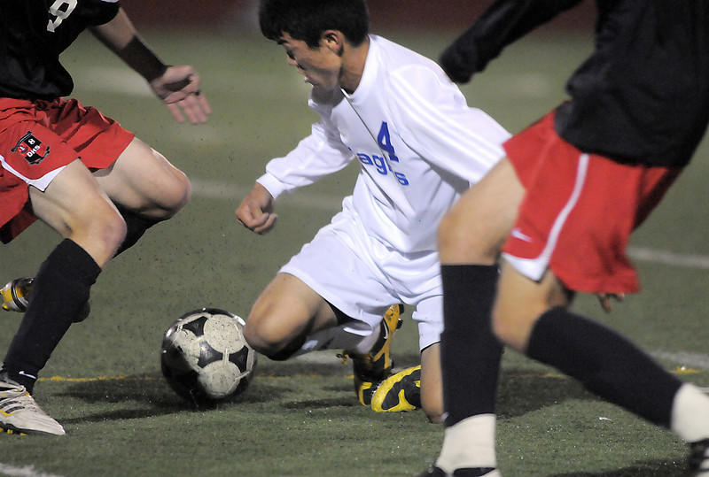 Broomfield's Alex Tagawa goes to the ground to take control of the ball from Durango during Wednesday's quarter finals game at Elizabeth Kennedy Stadium.<br /> November 3, 2010<br /> staff photo/David R. Jennings