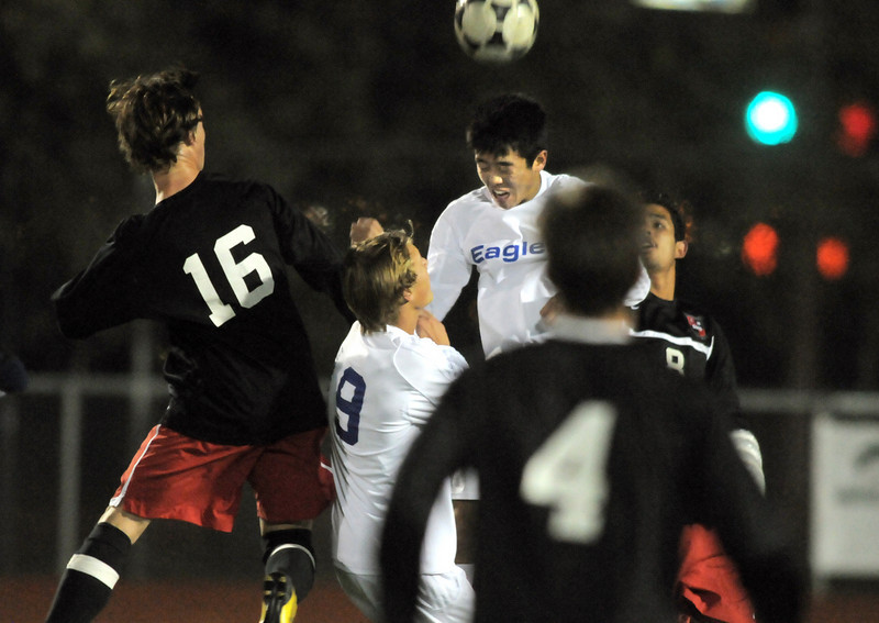 Broomfield's Alex Tagawa does a header over Durango players during Wednesday's quarter finals game at Elizabeth Kennedy Stadium.<br /> November 3, 2010<br /> staff photo/David R. Jennings