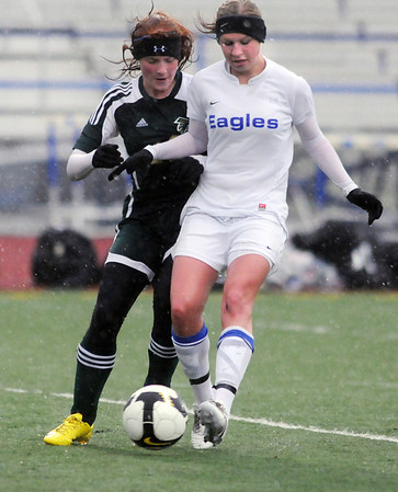 Morgan Rynearson, Broomfield, fights for control of the ball with Cassidy Rogers, Falcon, during Tuesday's game at Elizabeth Kennedy Stadium.<br /> May 11, 2010<br /> Staff photo/ David R. Jennings