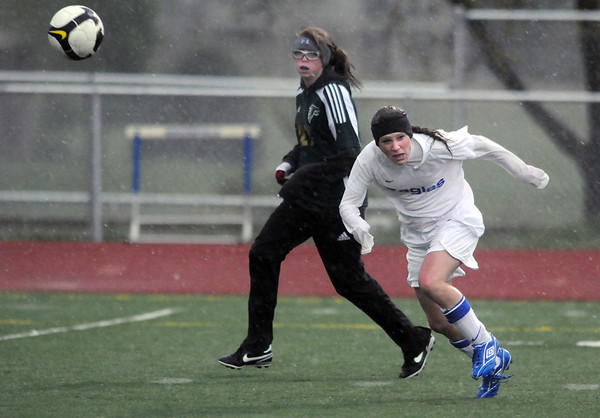 Lauren Snyder, Broomfield, moves the ball downfield past Sam Knoll, Falcon, during Tuesday's game at Elizabeth Kennedy Stadium.<br /> May 11, 2010<br /> Staff photo/ David R. Jennings