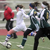 Baily Gabel, Broomfield, kicks the ball to the goal past Lauryn Klein and Megan Brooks, Falcon, during Tuesday's game at Elizabeth Kennedy Stadium.<br /> May 11, 2010<br /> Staff photo/ David R. Jennings