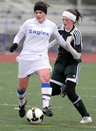 Caleigh Davis, Broomfield, takes control of the ball from Cora Buechner, Falcon, during Tuesday's game at Elizabeth Kennedy Stadium.<br /> May 11, 2010<br /> Staff photo/ David R. Jennings