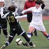 Caleigh Davis, Broomfield, moves the ball past Ally Vawter, Falcon, during Tuesday's game at Elizabeth Kennedy Stadium.<br /> May 11, 2010<br /> Staff photo/ David R. Jennings