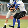 Ryan McCulley, Broomfield, tries to break a tackle from Thygerson, Fruita Monument during Friday's game at Elizabeth Kennedy Stadium.<br /> <br /> August 26, 2011<br /> staff photo/ David R. Jennings