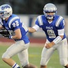 Broomfield's Ryan McCulley takes a handoff from quarterback Angelo Perez during Friday's game against Fruita Monument at Elizabeth Kennedy Stadium.<br /> <br /> August 26, 2011<br /> staff photo/ David R. Jennings