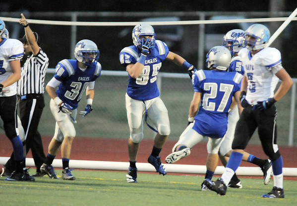 Broomfield's Kristian Niemi (85) celebrates after intercepting a pass from Fruita Monument during Friday's game at Elizabeth Kennedy Stadium.<br /> <br /> August 26, 2011<br /> staff photo/ David R. Jennings
