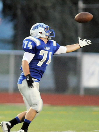 Jimmy Roberts, Broomfield punter, reaches for the ball after a high hike during Friday's game against Fruita Monument at Elizabeth Kennedy Stadium.<br /> <br /> August 26, 2011<br /> staff photo/ David R. Jennings