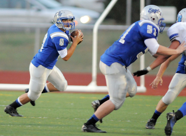 Broomfield's quarterback Angelo Perez eyes a receiver during Friday's game against Fruita Monument at Elizabeth Kennedy Stadium.<br /> <br /> <br /> August 26, 2011<br /> staff photo/ David R. Jennings