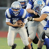 Broomfield's quarterback Angelo Perez runs with the ball during Friday's game against Fruita Monument at Elizabeth Kennedy Stadium.<br /> <br /> <br /> August 26, 2011<br /> staff photo/ David R. Jennings