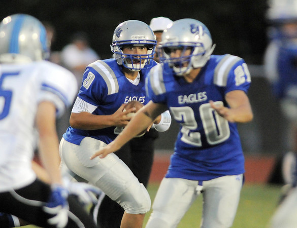 Broomfield's quarterback Angelo Perez eyes a receiver during Friday's game against Fruita Monument at Elizabeth Kennedy Stadium.<br /> <br /> August 26, 2011<br /> staff photo/ David R. Jennings
