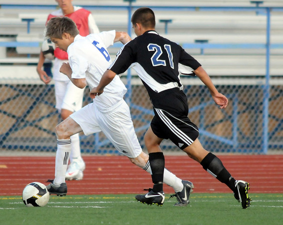 Trent Jarvis, left,  Broomfield High, keeps the ball from Nick Zadow, Grandview High during play Thursday at Elizabeth Kennedy Stadium.<br /> <br /> Sept. 3, 2009<br /> staff photo/David R. Jennings