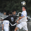 Cole Chapleski, right, Broomfield High, heads the ball away from Andrew Sierra, Grandview High during play Thursday at Elizabeth Kennedy Stadium.<br /> <br /> Sept. 3, 2009<br /> staff photo/David R. Jennings