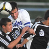 Broomfield High's Cole Chapleski fights to get the ball past Grandview High's Kenny Tribbett, left, and Andrew Sierra during play Thursday at Elizabeth Kennedy Stadium.<br /> <br /> Sept. 3, 2009<br /> staff photo/David R. Jennings