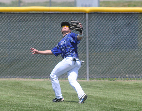 Broomfield's Dan Geubelle runs to catch the ball in center field during Saturday's game against Greeley Central at Broomfield.<br /> May 8, 2010<br /> Staff photo/ David R. Jennings
