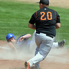 Broomfield's Nick Leonard rolls in the dirt after colliding with Greeley Central's Brandon Adamson at first base during Saturday's game at Broomfield.<br /> May 8, 2010<br /> Staff photo/ David R. Jennings
