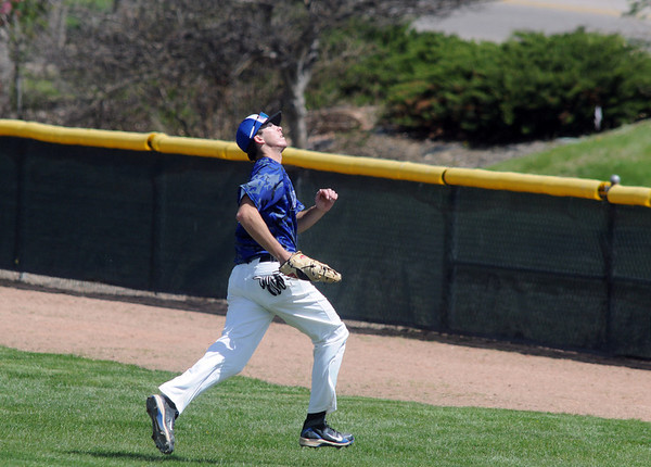 Broomfield first baseman Erik Lockwood runs to try and catch a  foul ball during Saturday's game against Greeley Central at Broomfield.<br /> May 8, 2010<br /> Staff photo/ David R. Jennings