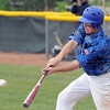 Broomfield's Jackson Lockwood makes a hit against Green Mountain during Saturday's 4A District game at Broomfield.<br /> <br /> May 12, 2012 <br /> staff photo/ David R. Jennings