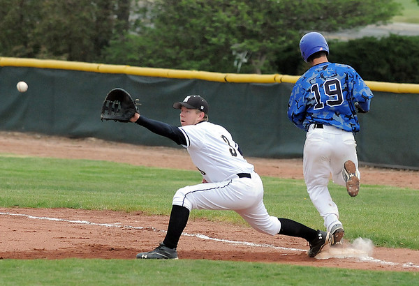 Broomfield's Brandon Bailey beats the ball to first base past Green Mountain's Eric Engle during Saturday's 4A District game at Broomfield.<br /> <br /> May 12, 2012 <br /> staff photo/ David R. Jennings