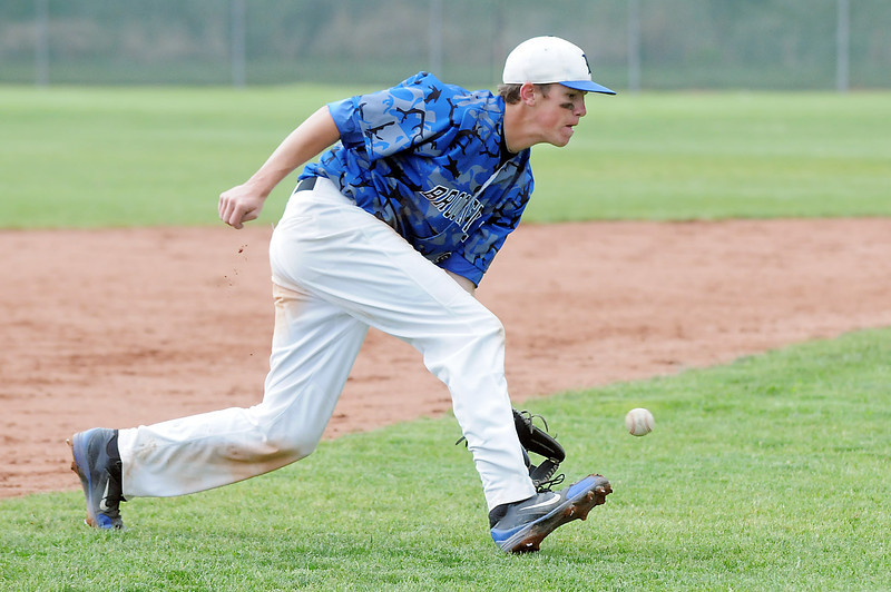 Broomfield's Jackson Lockwood scoops up a ground ball hit by Green Mountain during Saturday's 4A District game at Broomfield.<br /> <br /> May 12, 2012 <br /> staff photo/ David R. Jennings
