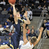 Legacy's Patrick Medina goes over Broomfield's Aric Kaiser to the basket during Saturday's cross town boys game at the 1stBank Center.<br /> January 8, 2011<br /> staff photo/David R. Jennings