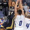 Phillip Kee, Legacy goes to the basket over Jackson Reddy and Aric Kaiser, Broomfield during Saturday's cross town boys game at the 1stBank Center.<br /> January 8, 2011<br /> staff photo/David R. Jennings