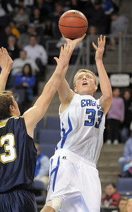 Broomfield's Dakota Smith shoots the ball over Legacy's Patrick Medina during Saturday's cross town boys game at the 1stBank Center. January 8, 2011 staff photo/David R. Jennings