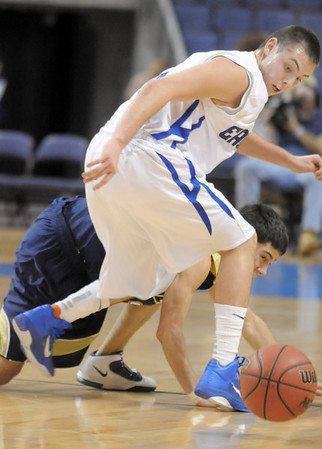 Broomfield's Jackson Reedy turns to a retrieve a loose ball past Legacy during Saturday's cross town boys game at the 1stBank Center.<br /> January 8, 2011<br /> staff photo/David R. Jennings
