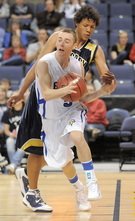 Austin Wood, Broomfield, keeps the ball inbounds and away from Phillip Kee, Legacy during Saturday's cross town boys game at the 1stBank Center.<br /> January 8, 2011<br /> staff photo/David R. Jennings