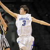 Nick Ongarato, Broomfield, reaches to intercept a pass to Cameron Rzonca, Legacy during Saturday's cross town boys game at the 1stBank Center.<br /> January 8, 2011<br /> staff photo/David R. Jennings