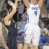 Aric Kaiser, Broomfield shoots over Cameron Rzonca, Legacy during Saturday's cross town boys game at the 1stBank Center.<br /> January 8, 2011<br /> staff photo/David R. Jennings