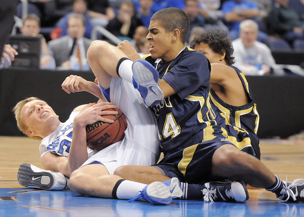 Keenan Creath, Legacy, and Dakota Smith, Broomfield fight for a loose ball during Saturday's cross town boys game at the 1stBank Center.<br /> January 8, 2011<br /> staff photo/David R. Jennings