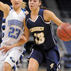 Taylor Archuleta, Legacy takes the ball down court against Morgan Rynearson, Broomfield during Saturday's cross town girls game at the 1stBank Center.<br /> January 8, 2011<br /> staff photo/David R. Jennings