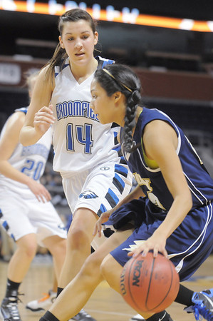Tayor Archuleta, Legacy drives the ball past Katie Nehf, Broomfield during Saturday's cross town girls game at the 1stBank Center.<br /> January 8, 2011<br /> staff photo/David R. Jennings