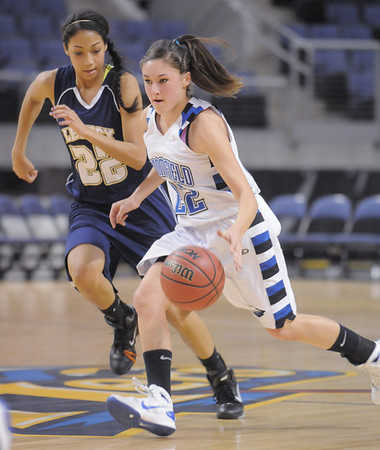 Brittney Zec,  Broomfield drives the ball down court with Kailey Edwards, Legacy behind her during Saturday's cross town girls game at the 1stBank Center.<br /> January 8, 2011<br /> staff photo/David R. Jennings