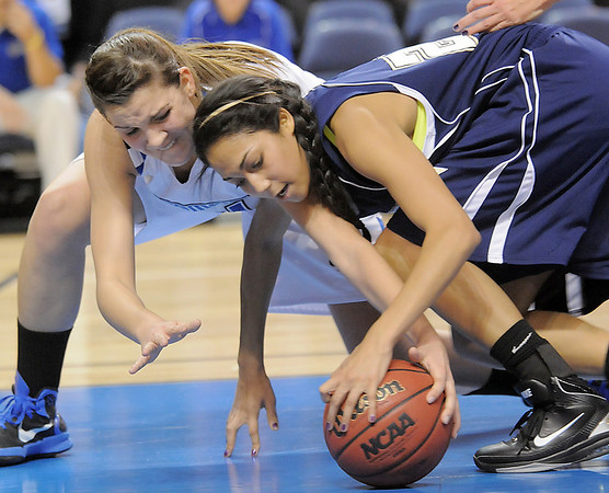 Lightning's Kailey Edwards and Eagle's Katie Nehf  go for a loose ball  during Saturday's cross town girls game at the 1stBank Center.<br /> January 8, 2011<br /> staff photo/David R. Jennings