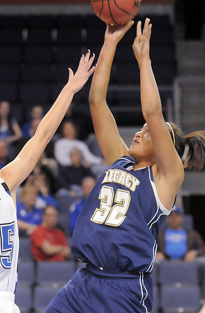 Sade Akindele, Legacy goes tot he basket past  Broomfield during Saturday's cross town girls game at the 1stBank Center.<br /> January 8, 2011<br /> staff photo/David R. Jennings