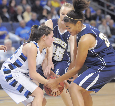Eagle's Brittney Zec battles for possession of the ball with Lightning's Sade Akindele and  Sarah Dunahay during Saturday's cross town girls game at the 1stBank Center.<br /> January 8, 2011<br /> staff photo/David R. Jennings