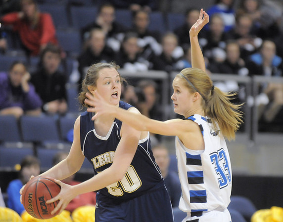 Jordan Eisler, Legacy, looks to pass the ball around Cherokee Rohrbaugh,  Broomfield during Saturday's cross town girls game at the 1stBank Center.<br /> January 8, 2011<br /> staff photo/David R. Jennings