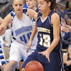 Taylor Archuleta, Legacy dribbles the ball past Taylor Schreter,  Broomfield during Saturday's cross town girls game at the 1stBank Center.<br /> January 8, 2011<br /> staff photo/David R. Jennings