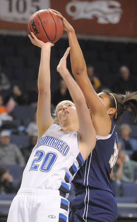 Meagan Prins, Broomfield, tries to shoot to the basket but is thwarted by Sade Akindele, Legacy during Saturday's cross town girls game at the 1stBank Center.<br /> January 8, 2011<br /> staff photo/David R. Jennings