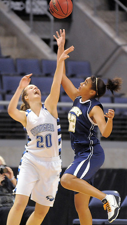 Eagle's Meagan Prins and Lightning's Sade Akindele reach for the ball  during Saturday's cross town girls game at the 1stBank Center.<br /> January 8, 2011<br /> staff photo/David R. Jennings