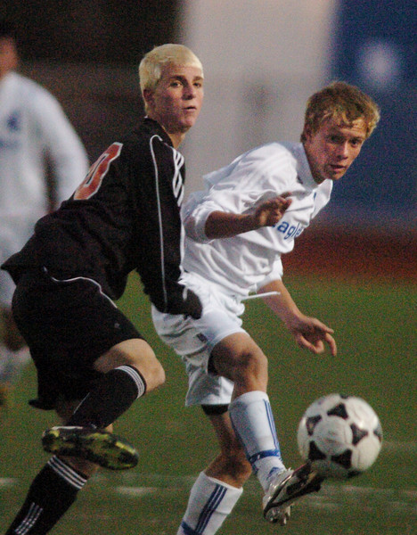 Broomfield's Thomas O'Brien kicks the ball downfield away from Lewis-Palmer's Tyler Pann during the first state playoff game on Wednesday at Elizabeth Kennedy Staduim.<br /> October 27, 2010<br /> staff photo/David R. Jennings