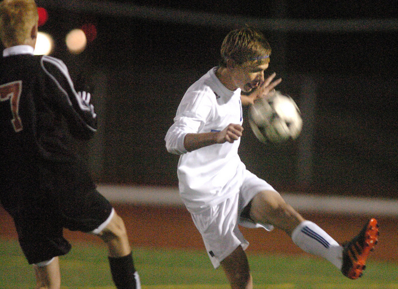 Broomfield's Austin Reece kicks the ball away from Lewis-Palmer's Autin Dell' Anno during the first state playoff game on Wednesday at Elizabeth Kennedy Staduim.<br /> October 27, 2010<br /> staff photo/David R. Jennings