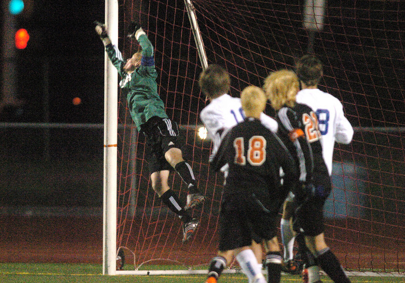 Broomfield's keeper Brendan Buchanan jumps to deflect the ball kciked by Lewis-Palmer during the first state playoff game on Wednesday at Elizabeth Kennedy Staduim.<br /> October 27, 2010<br /> staff photo/David R. Jennings